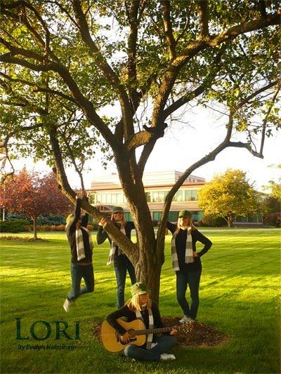Lori Playing Guitar Under a Tree