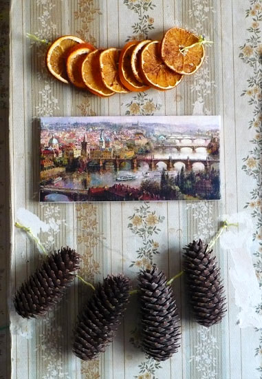 Wall Decorations of Dried Oranges, Pine Cones, and a Painting of Prague