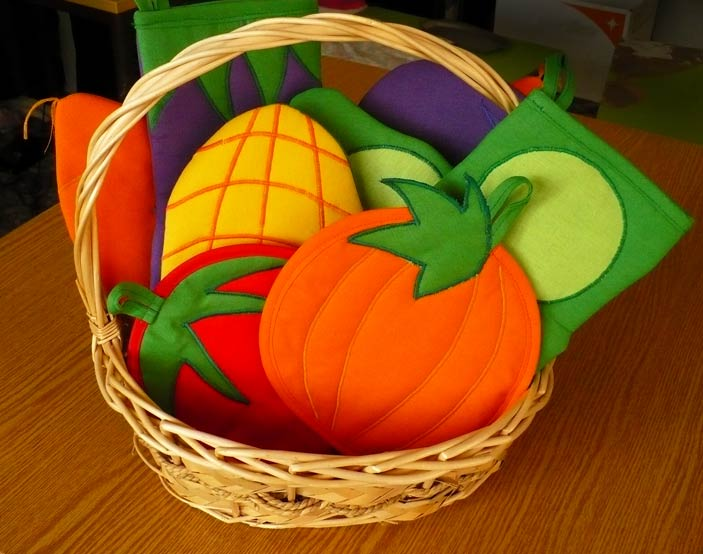 Oven Gloves and Pot Holders in a Vegetable Basket