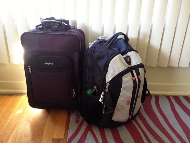 I moved with these two carry-on compatible pieces of luggage; the suitcase went in the overhead bin and the backpack went under the seat in front of me.